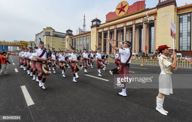 Vancouver Police Pipe Band from Canada perform during the opening parade of the 5th Nanchang International Military Tattoo on September 24 2017 in...