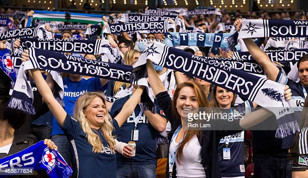Vancouver Whitecaps FC fans hold up their scarves while cheering on their team against the Portland Timbers in MLS action on March 28 2015 at BC...