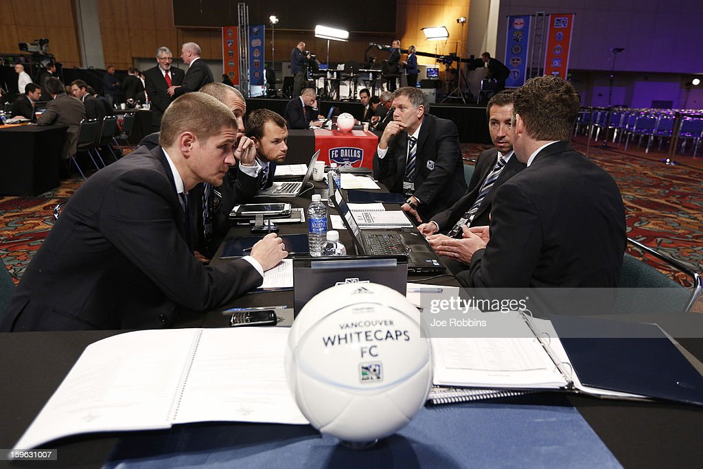 Vancouver Whitecaps FC officials discuss strategy prior to the 2013 MLS SuperDraft Presented by Adidas at the Indiana Convention Center on January 17, 2013 in Indianapolis, Indiana.