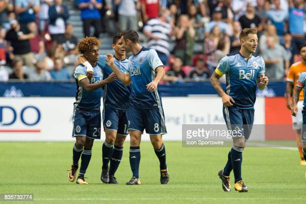 Vancouver Whitecaps forward Yordi Reyna is congratulated by midfielder Andrew Jacobson after scoring a goal during their match against the Houston...