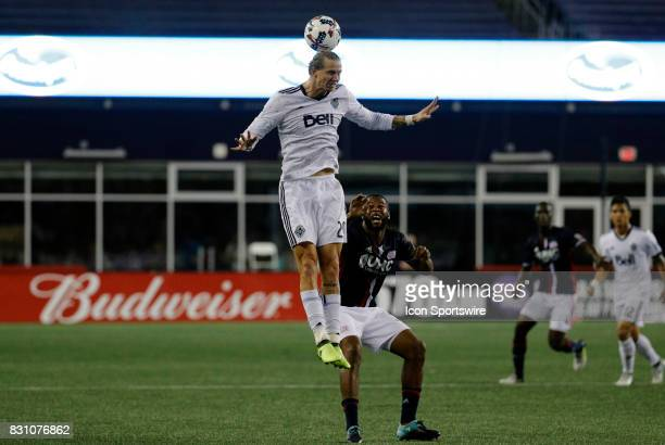Vancouver Whitecaps midfielder Brek Shea beats New England Revolution defender Andrew Farrell in the air during an MLS match between the New England...