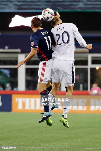 Vancouver Whitecaps midfielder Brek Shea beats New England Revolution midfielder Kelyn Rowe in the air during an MLS match between the New England...