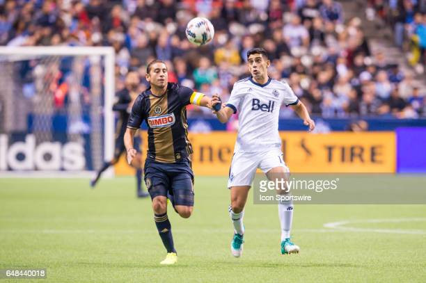 Vancouver Whitecaps midfielder Matias Laba and Philadelphia Union midfielder Alejandro Bedoya run to the ball during the game between the Vancouver...