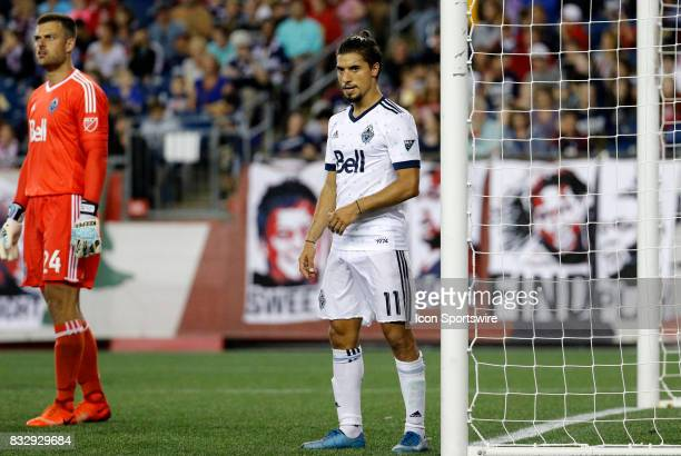 Vancouver Whitecaps midfielder Nicolas Mezquida guards the near post on a corner kick during an MLS match between the New England Revolution and...