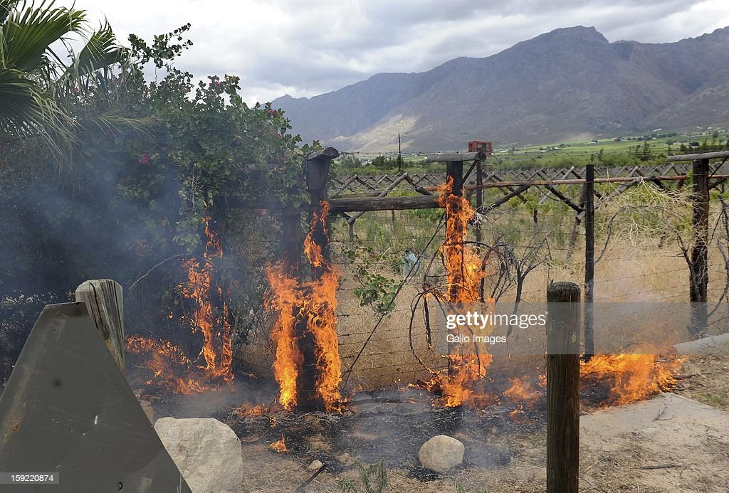 Vandalism to a nearby farm at the N1 De Doorns protest on January 9, 2013, in Cape Town, South Africa. The farm workers turned violent as they shut down the N1 by lighting tires on fire and placing large rocks on the road.