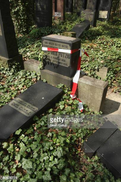 A vandalized gravesite is marked with police tape in a section of Berlin's biggest Jewish cemetery on April 30 2008 in Berlin Germany At least 30...