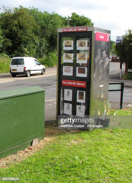 A vandalplagued phone box in Cradley West Midlands which has been given a new lease of life as what is thought to be Britain's smallest art gallery
