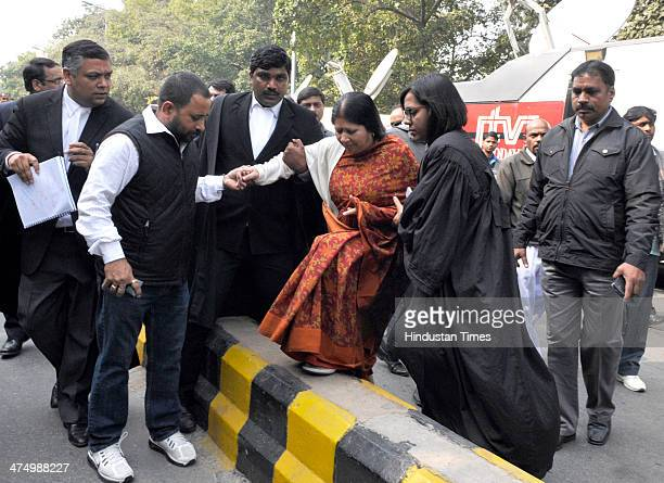 Vandana Bhargava one of the Directors of Sahara India with her advocate leaves the Supreme Court premises after the hearing on February 26 2014 in...