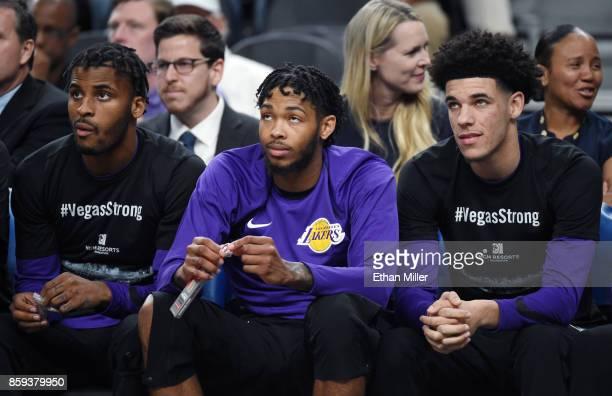 Vander Blue Brandon Ingram and Lonzo Ball of the Los Angeles Lakers sit on the bench during their preseason game against the Sacramento Kings at...