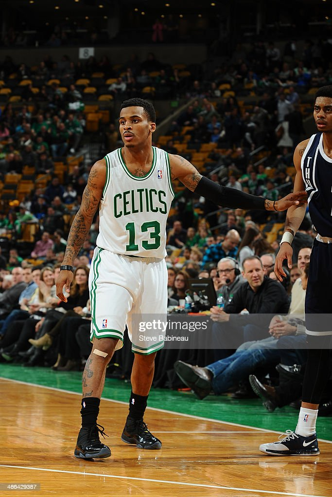 Vander Blue #13 of the Boston Celtics plays defense against the Oklahoma City Thunder on January 24, 2014 at the TD Garden in Boston, Massachusetts.
