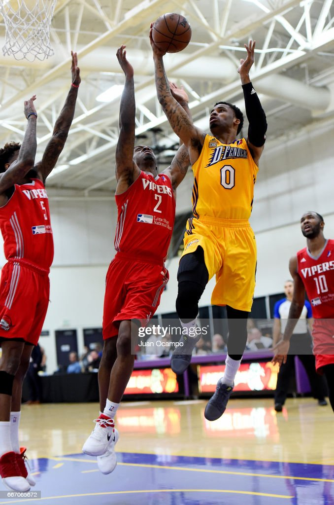 Vander Blue #0 of the Los Angeles D-Fenders goes to the basket against Sheldon McClellan #2 and Chris Walker #5 of the Rio Grande Valley Vipers in Game Three of the Western Division SemiFinals on April 10, 2017 at Toyota Sports Center in El Segundo, California.