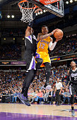 Vander Blue of the Los Angeles Lakers goes up for the shot against Jason Thompson of the Sacramento Kings on April 13 2015 at Sleep Train Arena in...