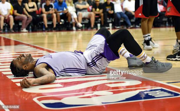 Vander Blue of the Los Angeles Lakers lies on the court after being called for an offnensive charge against the Portland Trail Blazers during the...