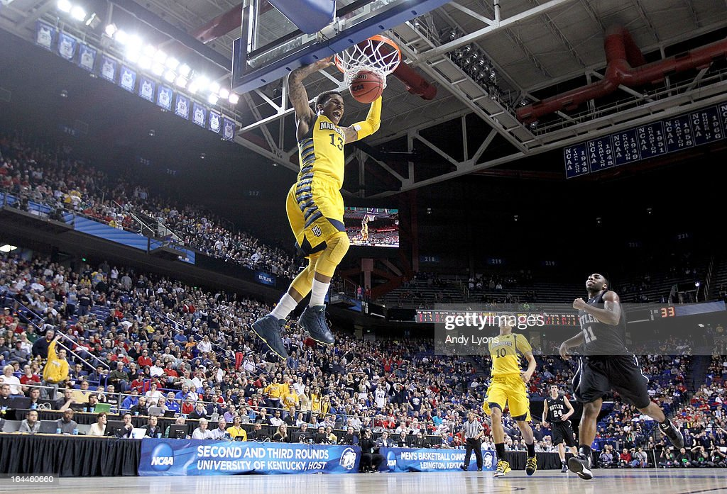 Vander Blue #13 of the Marquette Golden Eagles dunks the ball during the third round game against the Butler Bulldogs in the 2013 NCAA Men's Basketball Tournament at Rupp Arena on March 23, 2013 in Lexington, Kentucky.