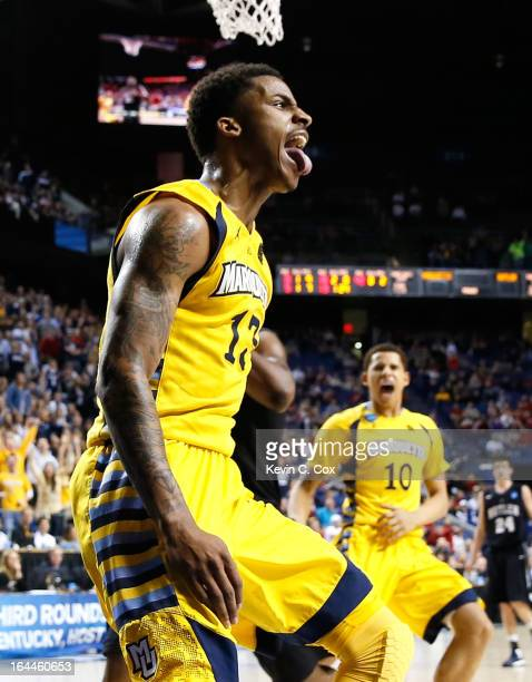 Vander Blue of the Marquette Golden Eagles reacts after stealing the ball and a dunk against the Butler Bulldogs in the second half during the third...