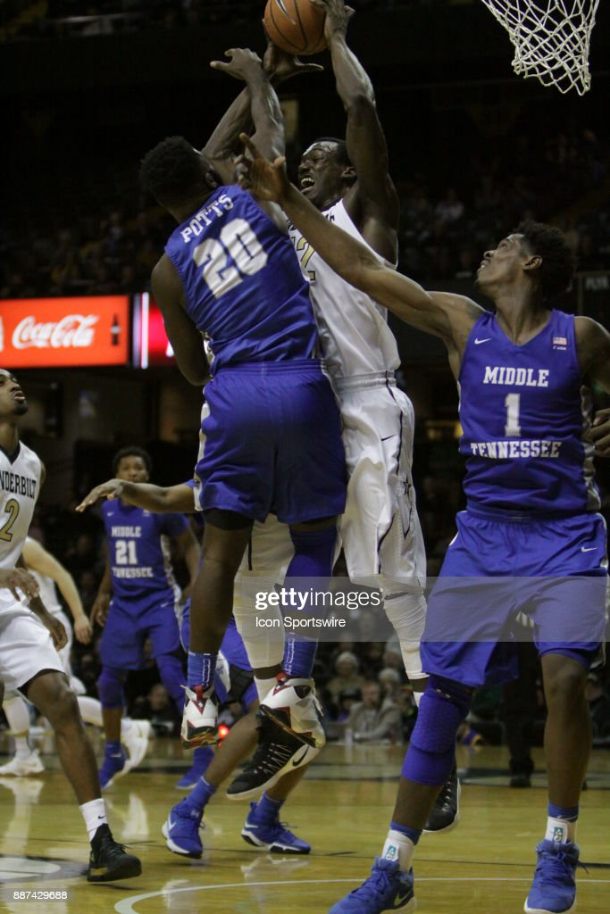 Vanderbilt Commodore forward Djery Baptiste (12) and Middle Tennessee Blue Raiders guard Giddy Potts (20) fight for a rebound in the first half during a college basketball game between the Middle Tennessee State Blue Raiders and the Vanderbilt Commodores on December 06, 2016 at Memorial Gym in Nashville, Tennessee.