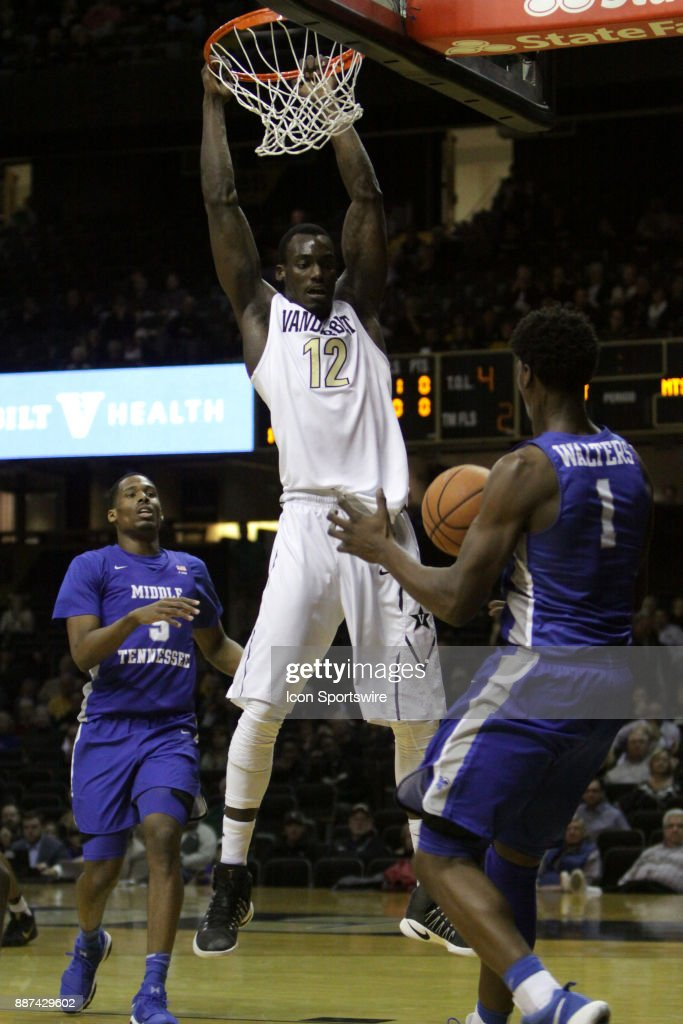 Vanderbilt Commodore forward Djery Baptiste (12) dunks over Middle Tennessee Blue Raiders forward Brandon Walters (1) the first half during a college basketball game between the Middle Tennessee State Blue Raiders and the Vanderbilt Commodores on December 06, 2016 at Memorial Gym in Nashville, Tennessee.