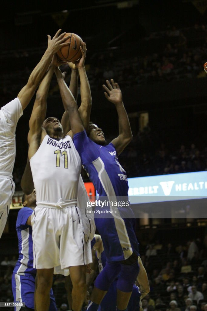Vanderbilt Commodore forward Jeff Roberson (11) and Middle Tennessee Blue Raiders forward David Simmons (21) fight for a rebound in the first half during a college basketball game between the Middle Tennessee State Blue Raiders and the Vanderbilt Commodores on December 06, 2016 at Memorial Gym in Nashville, Tennessee.