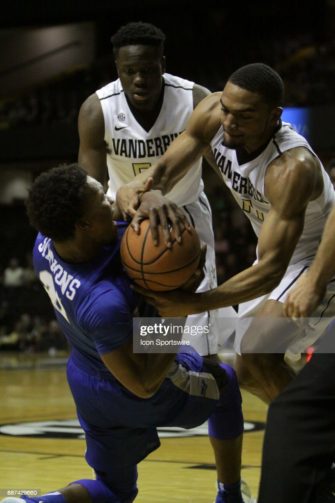 Vanderbilt Commodore forward Jeff Roberson (11) and Middle Tennessee Blue Raiders forward David Simmons (21) fight for a loose ball in the first half during a college basketball game between the Middle Tennessee State Blue Raiders and the Vanderbilt Commodores on December 06, 2016 at Memorial Gym in Nashville, Tennessee.