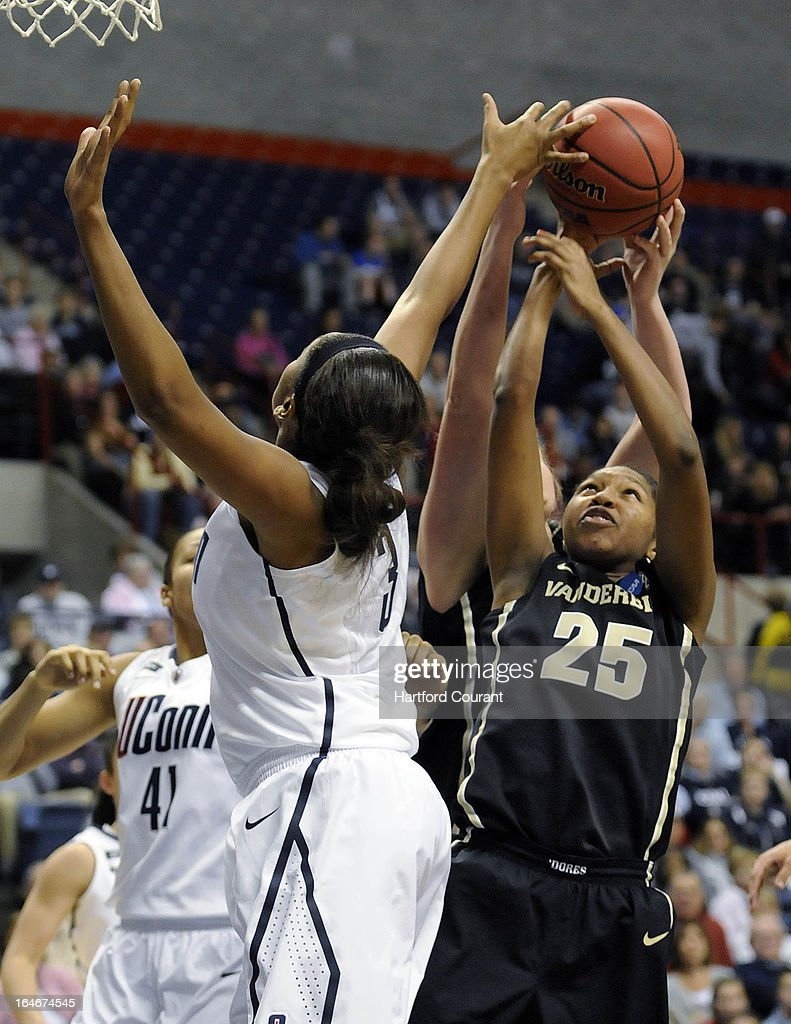 Vanderbilt Commodores guard Morgan Batey (25) fights Connecticut Huskies forward Morgan Tuck (3) for a rebound during the second half of the women's NCAA Tournament at Gampel Pavilion in Storrs, Connecticut, Monday, March 25, 2013.
