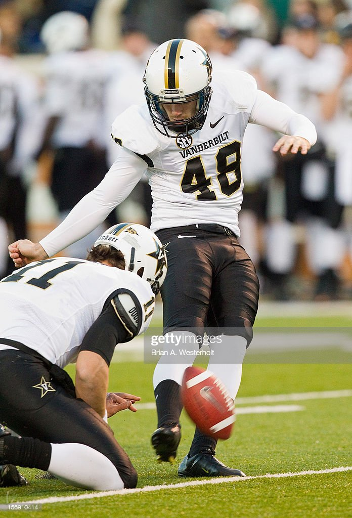 Vanderbilt Commodores kicker Ryan Fowler connects on an extra-point attempt against the Wake Forest Demon Deacons at BB&T Field on November 24, 2012 in Winston Salem, North Carolina. The Commodores defeated the Demon Deacons 55-21.