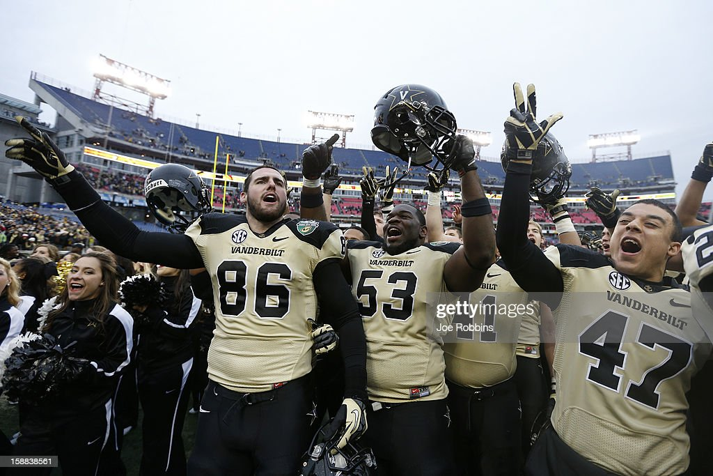 Vanderbilt Commodores players celebrate after the game against the North Carolina State Wolfpack during the Franklin American Mortgage Music City Bowl at LP Field on December 31, 2012 in Nashville, Tennessee. Vanderbilt won 38-24.