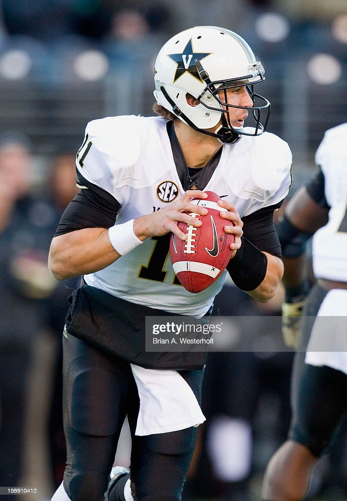 Vanderbilt Commodres quarterback Jordan Rodgers #11 rolls out to his right looking to pass the ball during first quarter action against the Wake Forest Demon Deacons at BB&T Field on November 24, 2012 in Winston Salem, North Carolina. The Commodores defeated the Demon Deacons 55-21.