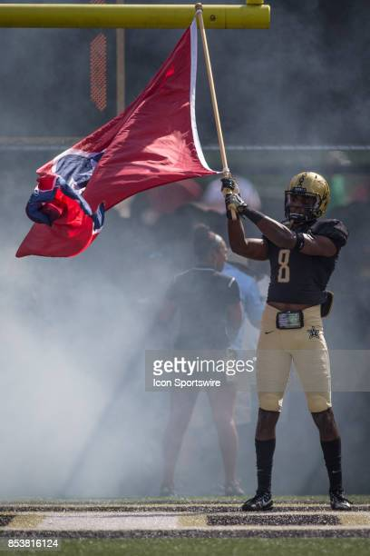 Vanderbilt Joejuan Williams waves the Tennessee State flag prior to a college football game between the Vanderbilt Commodores and the Alabama Crimson...