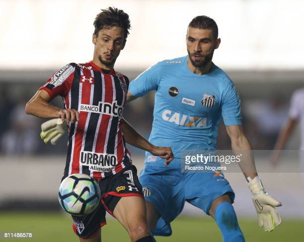 Vanderlei of Santos battles for the ball with Rodrigo Caio of Sao Paulo during the match between Santos and Sao Paulo as a part of Campeonato...