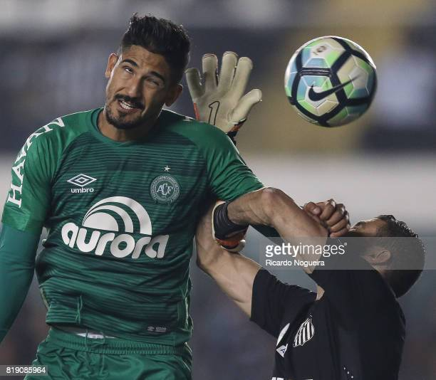 Vanderlei of Santos battles for the ball with Tulio de Melo of Chapecoense during the match between Santos and Chapecoense as a part of Campeonato...