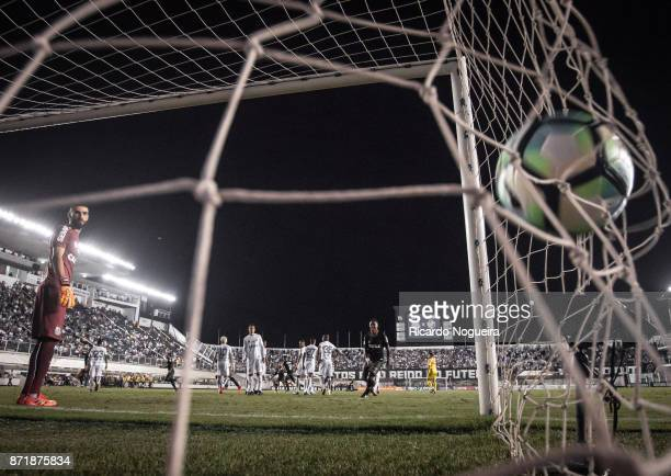 Vanderlei of Santos watches the ball enter into his goal after free kick by Nene of Vasco during the match between Santos and Vasco da Gama as a part...