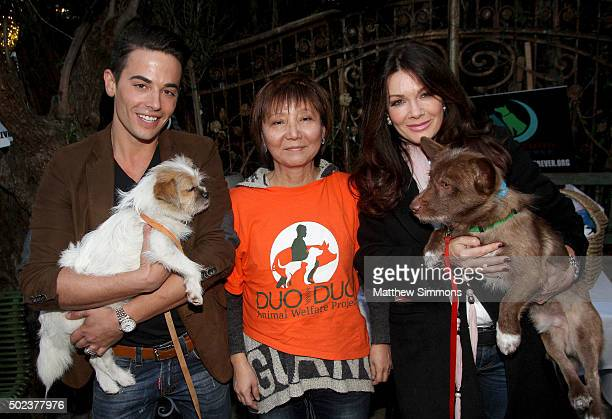 Vanderpump Pets COO John Sessa activist Andrea Gung and TV personality Lisa Vanderpump pose with dogs that were rescued from the Yulin dog meat...