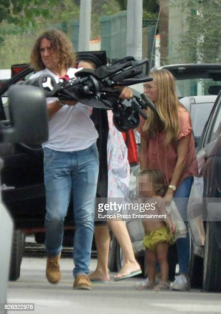 Vanesa Lorenzo and Carles Puyol arrive on the island of Ibiza with their daughter Maria on August 2 2017 in Ibiza Spain