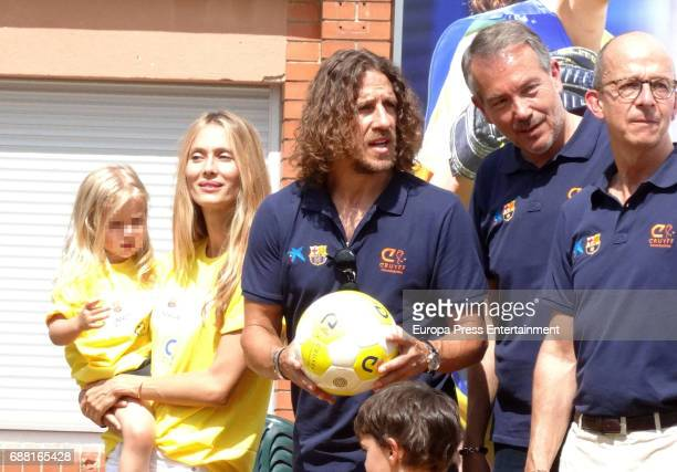 Vanesa Lorenzo Carles Puyol and their daughter Manuela Puyol attend the opening of the Cruyff Court Gerard Pique on May 24 2017 in Sant Guim de...