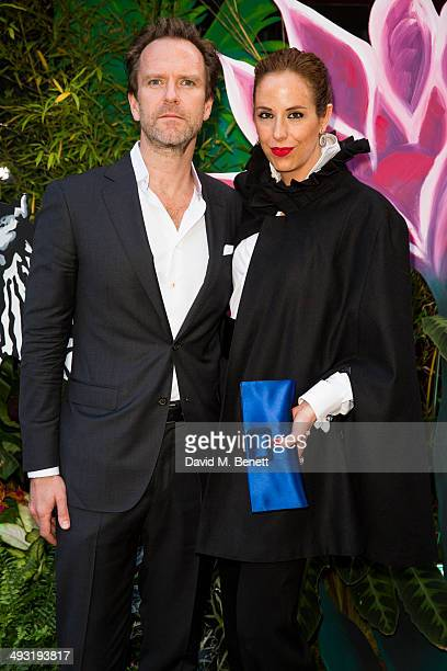 Vanessa Arelle and Stefan Georg arrives at Roger Vivier Summer Party at Loulou's on May 22 2014 in London England