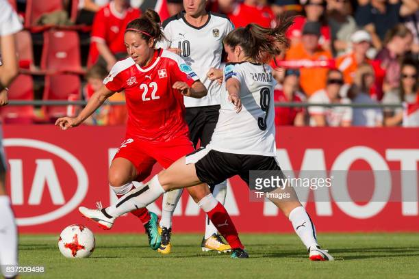 Vanessa Bernauer of Switzerland and Sarah Zadrazil of Austria battle for the ball during the Group C match between Austria and Switzerland during the...