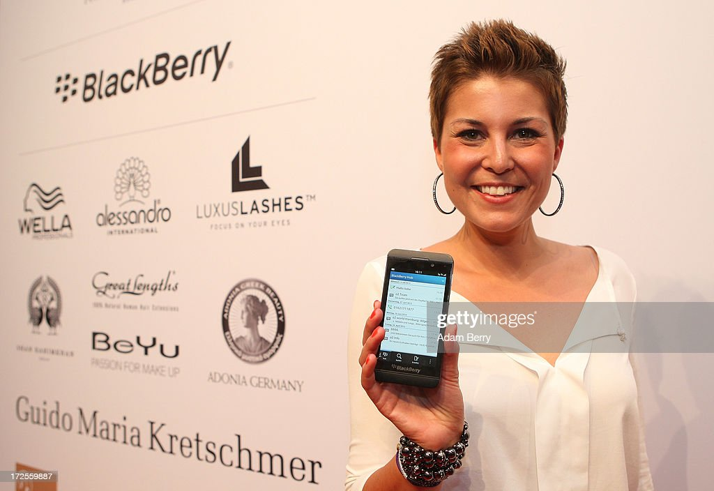 Vanessa Blumhagen poses with a Blackberry Z10 smartphone at the Blackberry Style Lounge during Mercedes-Benz Fashion Week in Berlin on July 3, 2013 in Berlin, Germany.