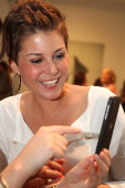 Vanessa Blumhagen tries out a Blackberry Z10 smartphone at the Blackberry Style Lounge during MercedesBenz Fashion Week in Berlin on July 3 2013 in...