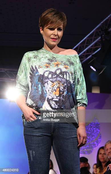 Vanessa Blumhagen walks the runway at the Manou Lenz 'Love Happiness' fashion show on July 8 2015 in Berlin Germany