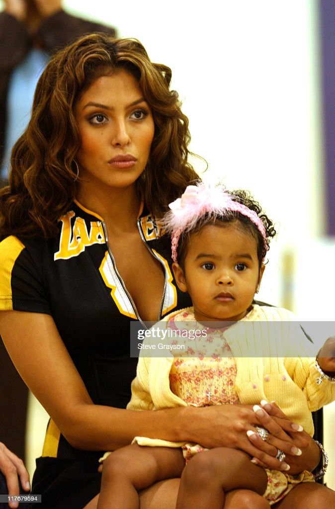Vanessa Bryant wife of unrestricted free agent Kobe Bryant and their daughter Natalia listen to Kobe speak at a press conference to announce he will...