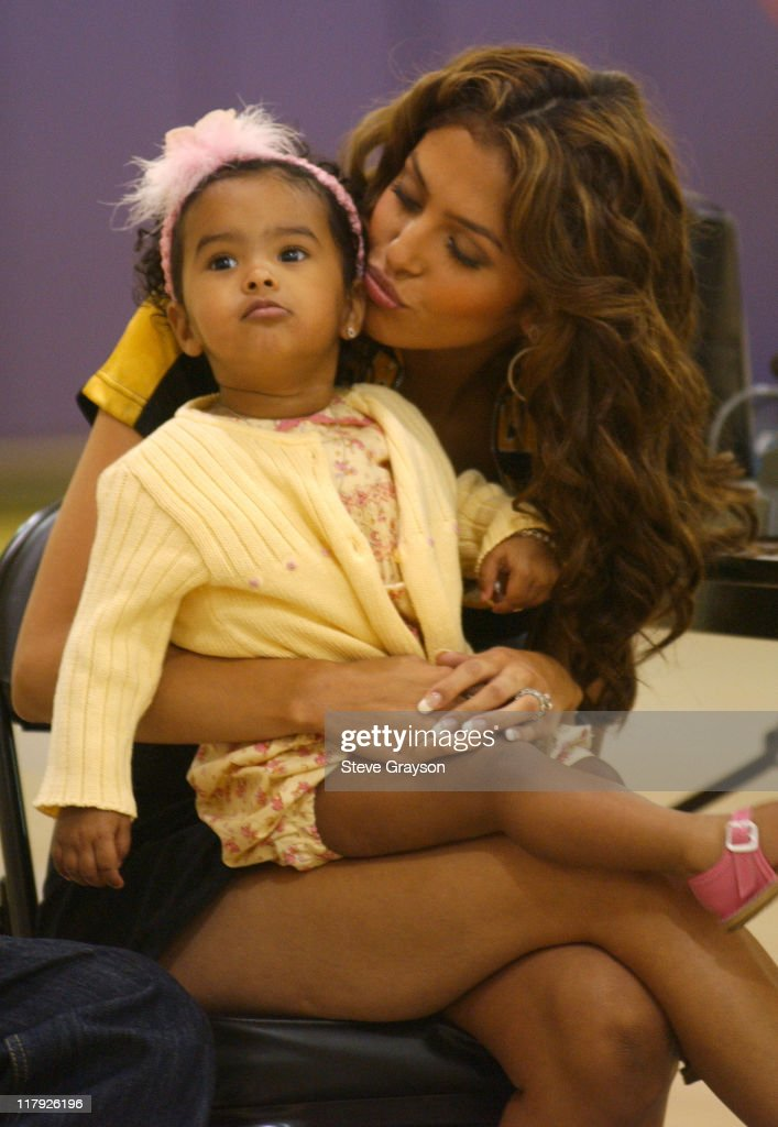 Vanessa Bryant wife of unrestricted free agent Kobe Bryant kisses their daughter Natalia while listening to Kobe speak at a press conference to...