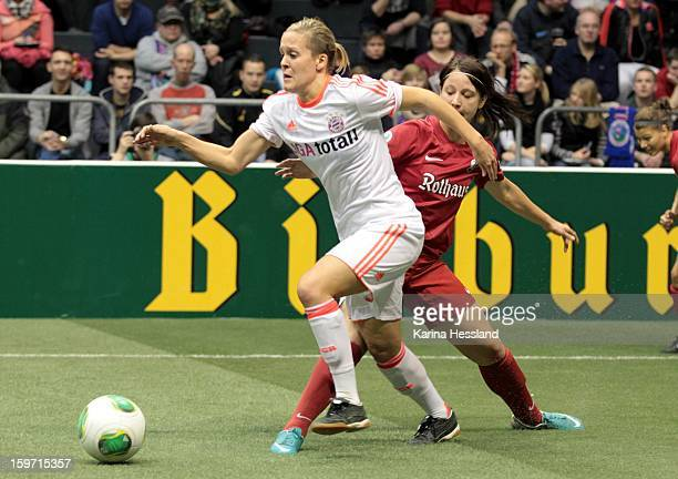 Vanessa Buerki of FC Bayern Muenchen challenges Sylvia Arnold of SC Freiburg 1904 during the DFB Women's Indoor Cup 2013 at the GETECArena on January...