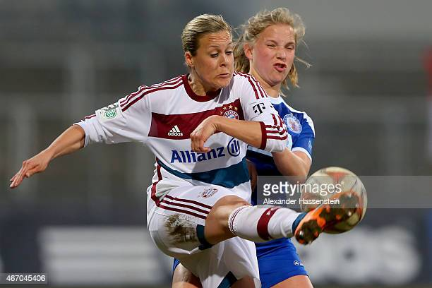 Vanessa Buerki of Muenchen battles for the ball with Tabea Kemme of Potsdam during the Allianz FrauenBundesliga match between FC Bayern Muenchen and...