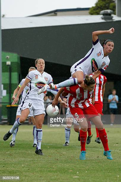Vanessa DiBernardo of Perth Glory jumps on Larissa Crummer of Melbourne City in an attempt to head the ball during the round 10 WLeague match between...