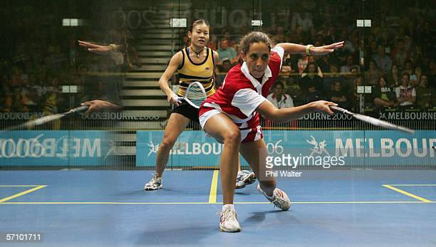 Vanessa Florens of Mauritius plays a forehand against Tricia Chuah of Malaysia in a reflection on the glass of the court during their womens singles...