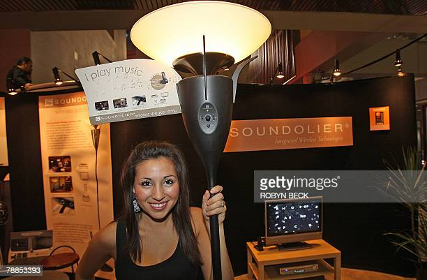 Vanessa Gonzales stands beside the Soundolier wireless Speaker Lamp at the 2008 Consumer Electronics Show in Las Vegas 09 January 2008 The Soundolier...