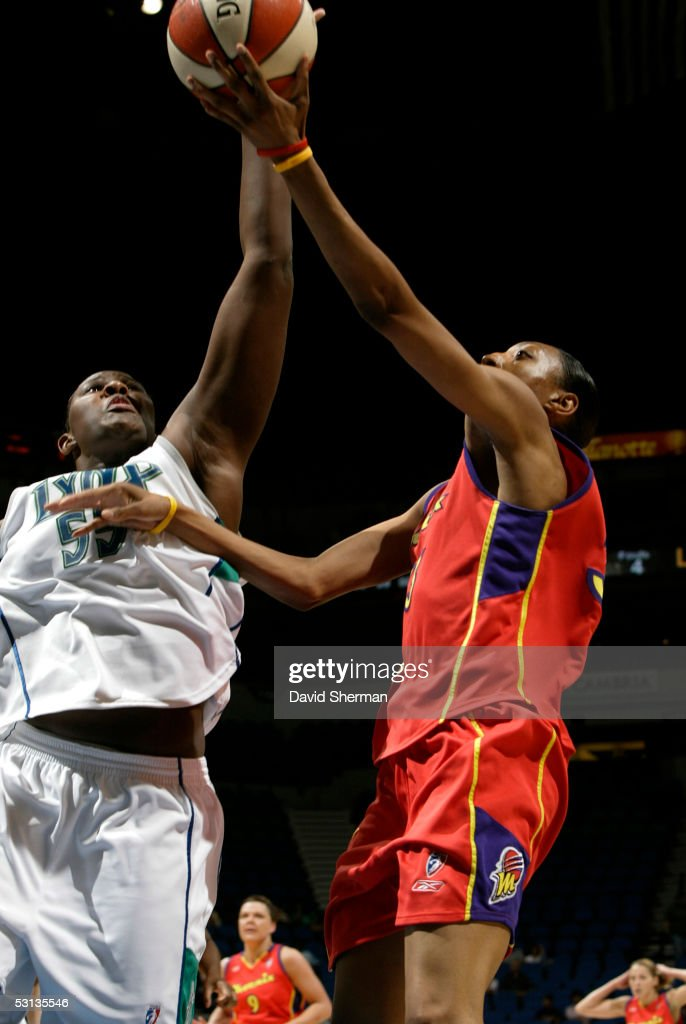 Vanessa Hayden of the Minnesota Lynx blocks the ball against Angelina Williams of the Phoenix Mercury on June 22 2005 at the Target Center in...