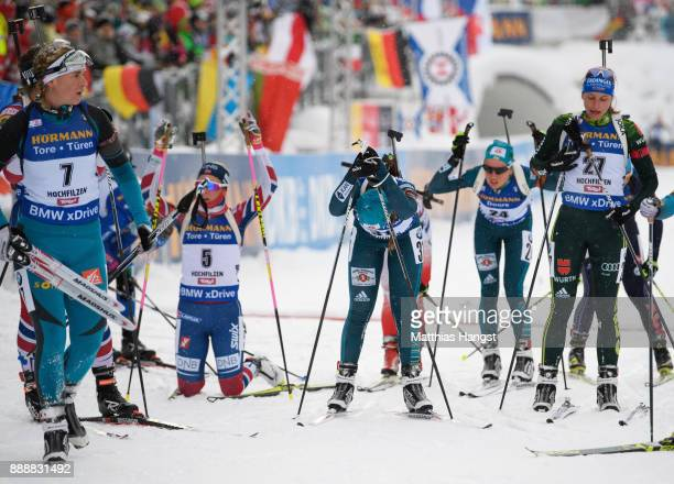 Vanessa Hinz of Germany and other athletes react after the 10 km Women's Pursuit during the BMW IBU World Cup Biathlon on December 0 2017 in...