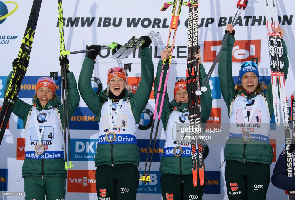 Vanessa Hinz of Germany, Franziska Hildebrand of Germany, Maren Hammerschmidt of Germany and Laura Dahlmeier of Germany celebrate on the podium for the Women's 4x 6km relay competition of the BMW IBU World Cup Biathlon on December 10, 2017 in Hochfilzen, Austria.