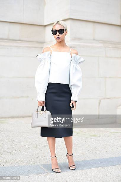 Vanessa Hong poses wearing a JH Zane dress and Prada bag on Day 5 of Paris Fashion Week Womenswear FW15 on March 7 2015 in Paris France